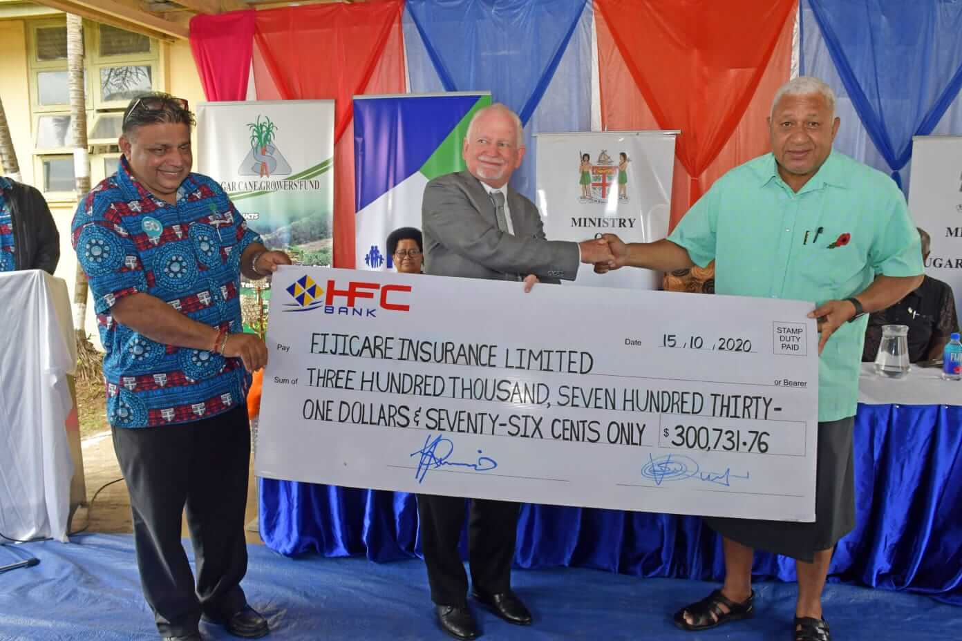 PM hands over $300k of grant for Cane Farmers Insurance..